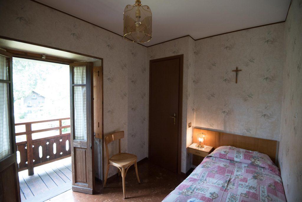 camera con letto singolo e balcone